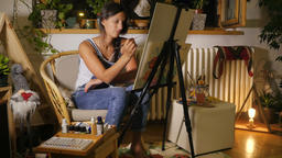 Young woman drawing something ih ner studio Footage