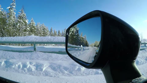 Driving on a Winter Road on a Sunny Day Footage