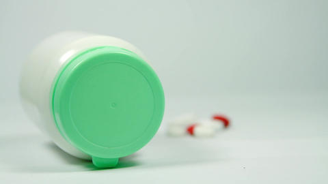 Bottle Of Medicine And Pills Isolated On White, Rack Focus Footage