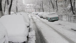 Street With Cars In Winter, Tire Marks In Snow, Blizzard, Winter, Still Shot Live Action