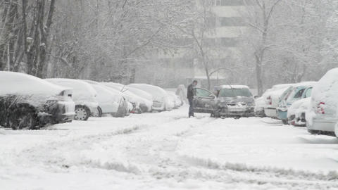 Parking Lot With Cars Covered In Snow, Blizzard, Extreme Weather, Winter, Pan Footage