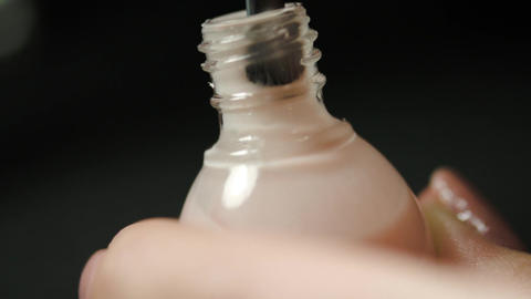 Woman Hands Opening A Bottle Of Nail Polish ビデオ