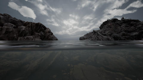 Half underwater in northern sea with rocks Live Action