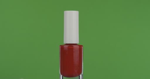 Close-up, rotation of red nail polish, on a green screen ライブ動画