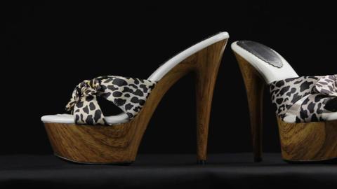 Close-up, a pair summer high-heeled shoes and platform. Slider shot. Female Live Action
