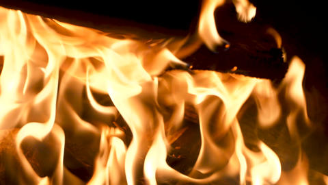 Close up of flames, burning piles of wood Acción en vivo