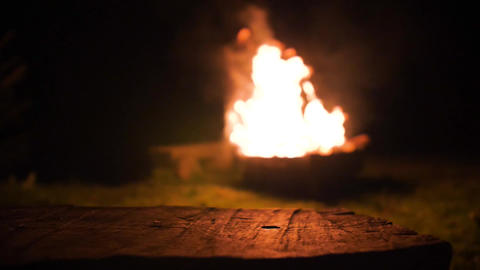 Blurry camp fire, shot from the wooden bench, still shot ライブ動画