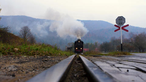 Approaching narrow gauge railway (locomotive) with the mountain view in the background Live Action