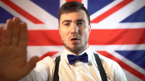 British politician takes an oath, sings a hymn Live Action