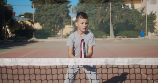 Tennis game, ambitious tennis player boy concentrating and focusing on game Live Action