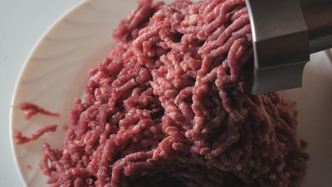 Cutting of meat of wild elk. Dark raw meat processing. Cooking in a meat grinder Live Action
