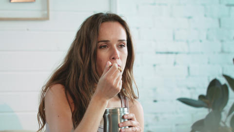 Closeup attractive woman eating ice cream with spoon from metal jar at home Live Action