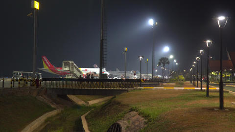 Airplanes parking at Siem Reap International Airport tarmac in the night Live Action