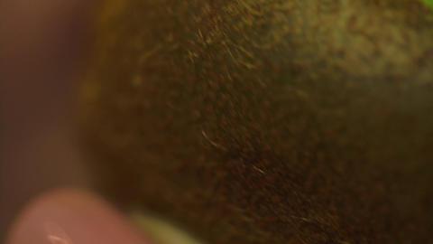 Macro Shot Of A Woman Hands Peeling A Kiwi With A Peeler Footage