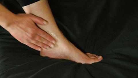 Woman Massaging Her Ankle With A Numbing Cream, Ankle Pain, Injury, Rheumatism Live Action
