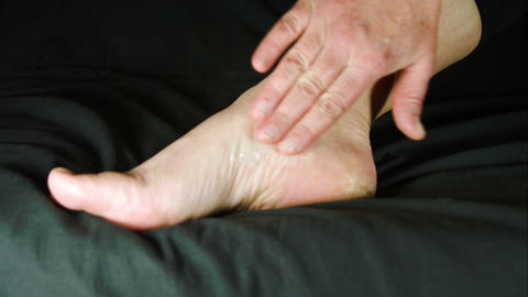Woman Massaging Her Foot With Numbing Cream, Pain, Rheumatism, Injury Live Action