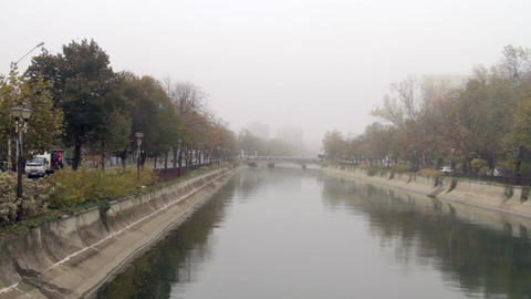 Downtown Bucharest On A Foggy Autumn Day, Pan Over The River, Traffic, Cold Day Footage