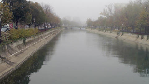 Downtown Bucharest On A Foggy Autumn Day, Tilt Over The River, Traffic, Cold Day Live Action