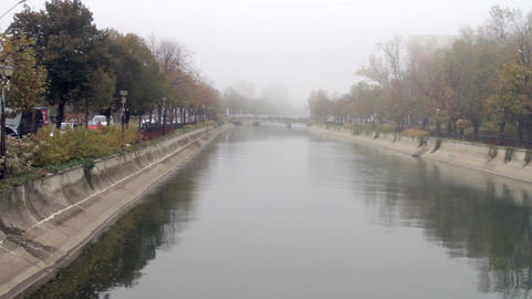 Downtown Bucharest On A Foggy Autumn Day, Tilt Over The River, Traffic, Cold Day Footage
