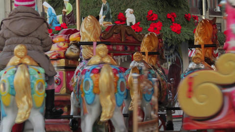 Happy Kids In Winter Fair Carousel, Merry Go Round, Close Up Footage
