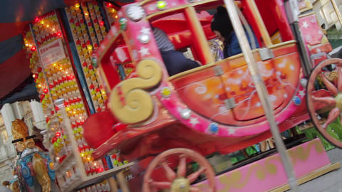 Happy Kids In Winter Fair Carousel, Merry Go Round, Dutch Angle Footage