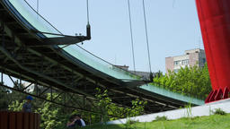 Modern Round Bridge In The Park, Sunny Day, Modern Design, Pan Footage