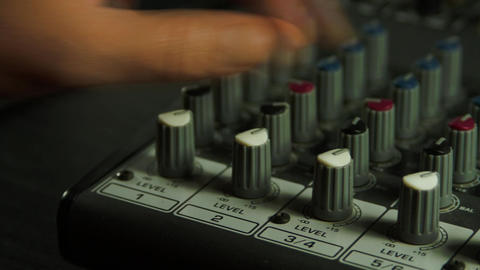 Editor's Hand Adjusting Sound Level On Mixer, Media, Technology, Sound Equipment Footage