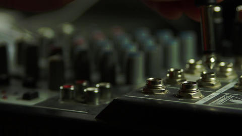 Editor's Hand Inserting Jacks Into Sound Mixer, Sound Equipment, Technology, Pan Live Action