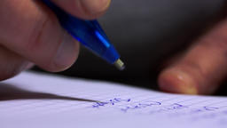 Macro Shot Of A Woman Hand Writing A shopping List Footage