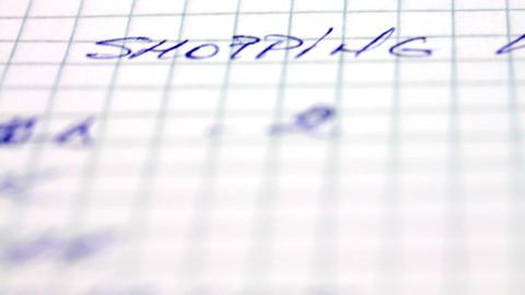Short Tilt Over A Hand Written Shopping List Footage