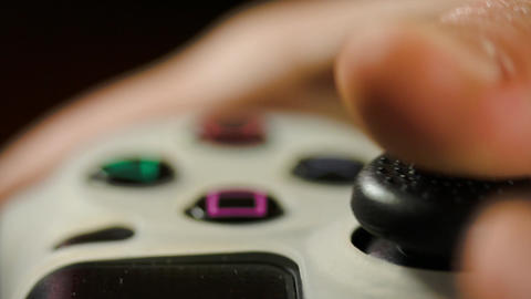 Boy's Hands Playing A video Game Using A Gaming Controller Footage