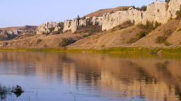 Pan from two canoes on the banks of the Missouri River to the white cliffs in Mo Footage