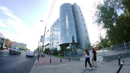 Business Building In Bucharest, Modern Architecture, Traffic, Busy Day Live Action
