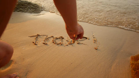 A man writes a word in the sand, summer vacation concept Live Action