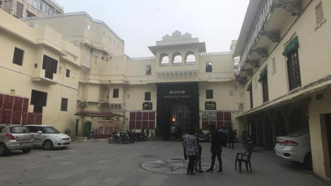 Udaipur, India - November 12, 2019: tourists relax in the shade of the building Live Action