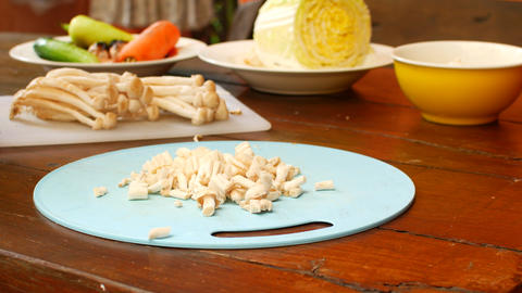 Cut mushrooms for frying vegetables, prepare healthy food Live Action