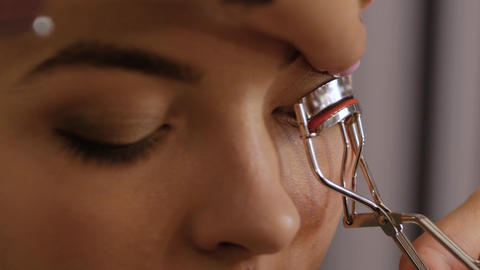 Eyelash curlers closeup Live Action