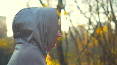 Portrait of a girl in a light jacket in an autumn or spring park. The girl in Live Action