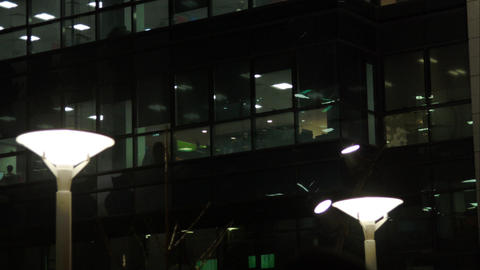 Business Center At Night, Illuminated, Street Lamp, People On The Street Live Action