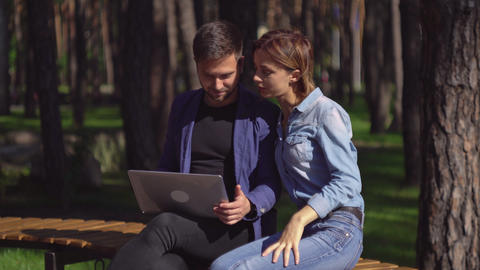 Businessman and businesswoman meet at the open air discussing project Footage