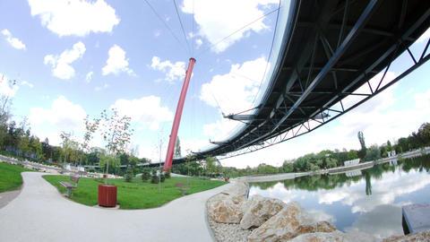 Beautiful Park Seen From Under Bid Round Bridge, Summer Day, Modern Design Footage