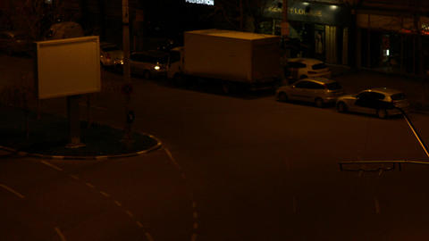 Night Traffic On A Street Late At Night, Aerial View, Pan Live Action