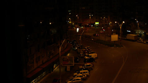 Aerial View Of A Street Late At Night, Night Traffic, Cars Passing By, Pan Footage