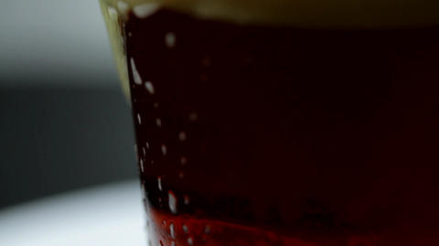 Macro Of Dark Beer Foam Spilling On The Side Of Glass, Summer, Thirst, Heat Footage
