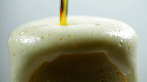 Pouring Cold Dark Beer In A Tall Iced Glass, Foam Spilling, Thirst, Heat, Macro Footage