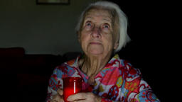 Very Old Woman Blowing In A Candle Lit For The Dear Departed Ones, Loneliness Footage