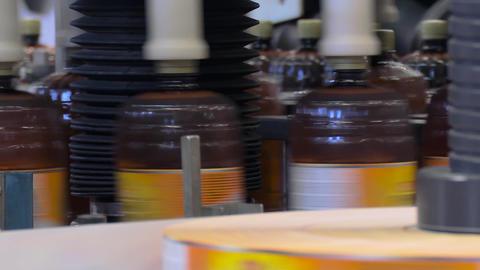 Beer in brown plastic bottles on the conveyor Live Action