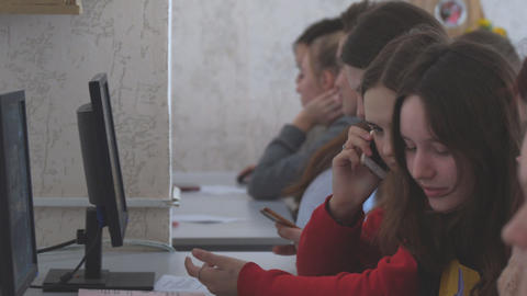 Female students in front of computers in a computer class Live-Action