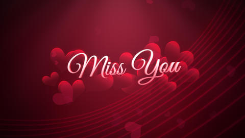 Animated closeup Miss You text and motion romantic heart on Valentine day shiny background CG動画