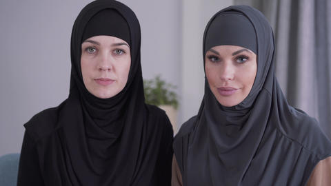 Close-up of conservative and modern-looking Muslim women looking at camera and Live Action